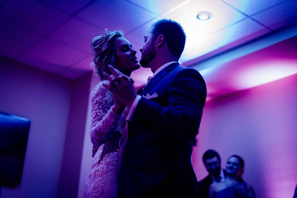 Pink-lighted wedding couple dance photography